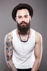 handsome Bearded Man in Hat, with tattoo