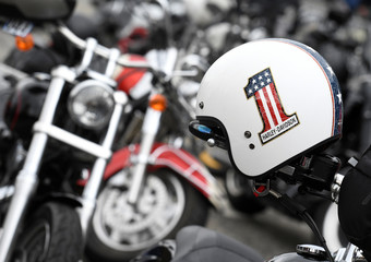 """A helmet is pictured in front of Harley-Davidson bikes at the """"Hamburg Harley Days"""" in Hamburg"""