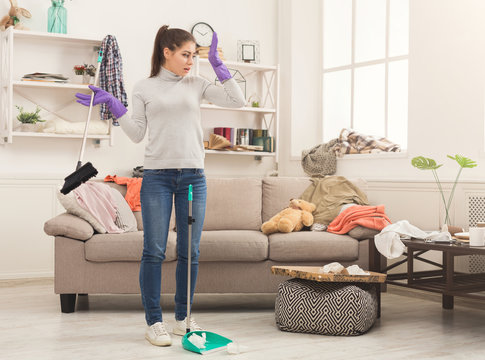 Woman with special equipment cleaning house