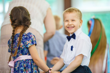 happy little boy dancing with girl holiday