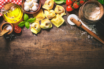 Top view on homemade pasta ravioli on old wooden table