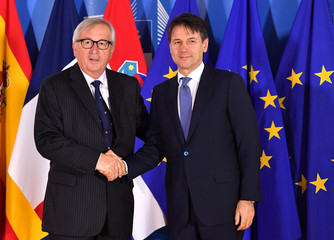 European Commission President Jean-Claude Juncker shakes hands with with Italian Prime Minister Giuseppe Conte during an informal EU summit on migration at EU headquarters in Brussels