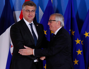 Croatian Prime Minister Andrej Plenkovic is welcomed by European Commission President Jean-Claude Juncker at the start of an emergency European Union leaders summit on immigration at the EU Commission headquarters in Brussels