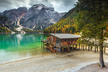 Wall Mural - Wonderful wooden boathouse on the alpine lake, Dolomites, Italy, Europe