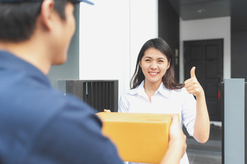 Happy woman received package from delivery man