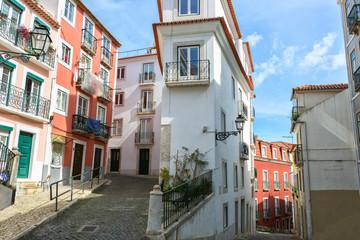 Narrow winding street in the Alfama, Lisbon, Portugal.