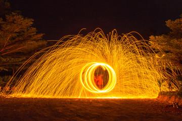 burning steel wool spinning,circle Fire at night