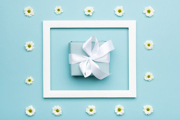 Happy Father's day Pastel Blue Candy Colours Background. Flat lay minimalism greeting card with picture frame and beautiful present.