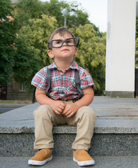 Portrait of smart little boy in glasses. Little student boy ready for learning, people, education and school concept