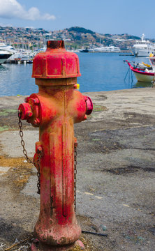 Ancient fire pump of water in the port of Sanremo.