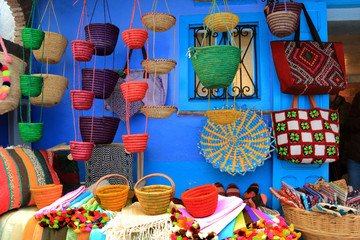 Shop of colorful handmade bags in Chefchaouen, Morocco