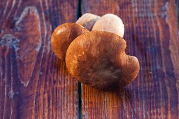 boletus edulis over Wooden Background. Autumn Cep Mushrooms. Cooking delicious organic mushroom. Gourmet food