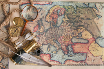 Planning a trip: quill pen, old papers and maps with vintage items