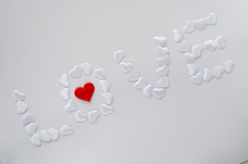 Red and white hearts on background isolated top view