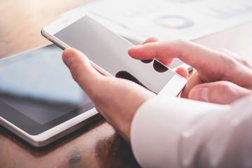 Businessman Analyzing Financial Statistics With Smartphone