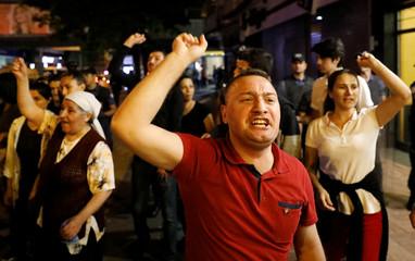 People on their way to the High Electoral Board (YSK) protest against Turkish president Tayyip Erdogan in Ankara