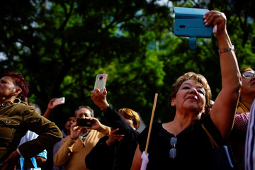 "Supporters of Ricardo Anaya, presidential candidate for the National Action Party (PAN), a part of the leading coalition ""For Mexico in Front"", make images with cell phones during his closing campaign rally at the Angel of Independence monument in Mexico C"