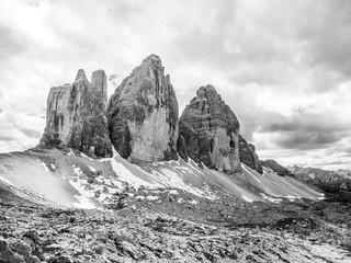 Tre Cime di Lavaredo, aka Drei Zinnen, rock formation in Dolomites, Italy. Black and white image.
