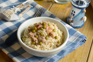 rice with peas and tuna in the white bowl