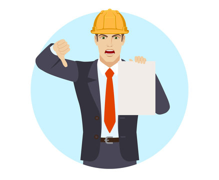Businessman in construction helmet showing the blank paper and showing thumb down. Gesture as rejection symbol down