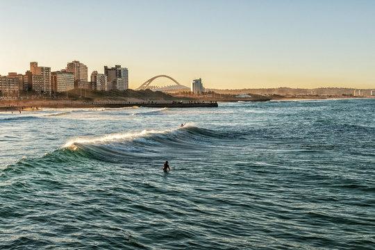 Surfers Enjoying the Waves at Sunset