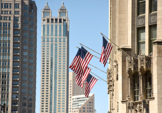 American flag on a building in downtown of Chicago