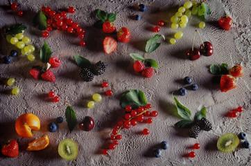 фрукты и ягоды на фоне мороженного fruits and berries on an ice cream background