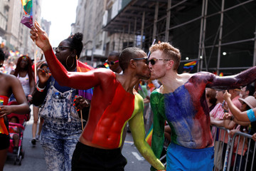 People kiss as they participate in the 2018 New York City Pride Parade in Manhattan, New York