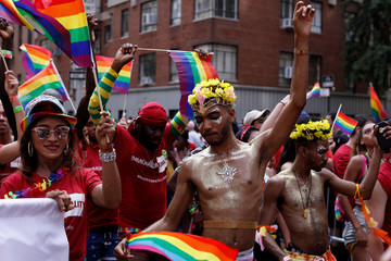 People dance as they participate in the 2018 New York City Pride Parade in Manhattan, New York