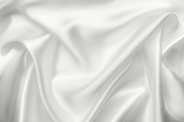 Elegant white satin silk with waves, abstract background