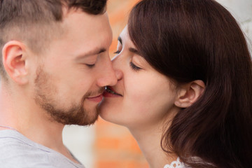 Closeup photo of kissing couple
