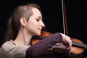 young woman playing folk violin