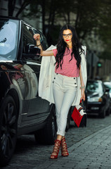 Beautiful young glamour woman in stylish outfit, posing in the city. Street style fashion.