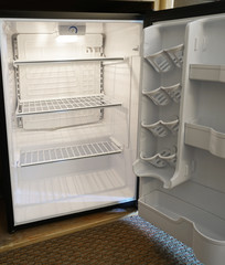 close up on empty refrigerator with door open