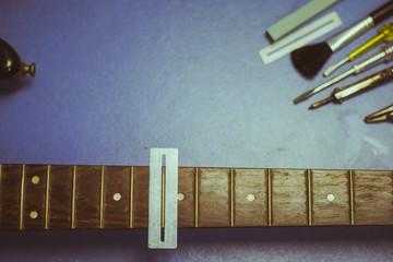 electric guitar on guitar repair desk