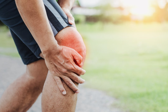 runner sport with running knee injury at park