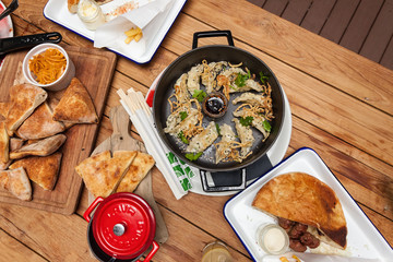 Dim-sum served in iron pot on wooden background