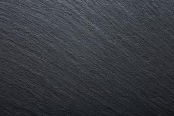 Dark grey and black slate granite background. Texture background for your project.