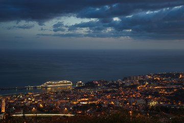 After sunset panoramic view to Funchal with atlantic ocean and cruise ship, Madeira