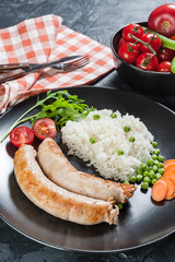 Grilled sauseges with boiled rice