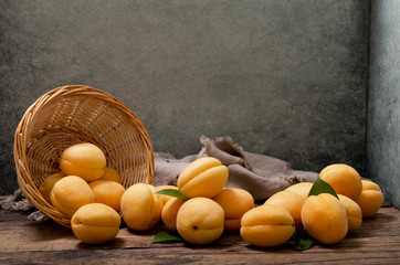 apricots in a basket on wooden table