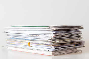 Pile of mails on white background