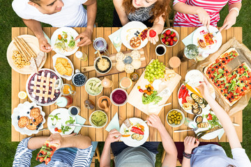 Top view on table with healthy food during meeting of friends