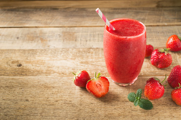 Strawberry smoothie and fresh raw berries