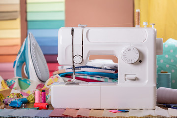 Sewing machine, sewing accessories and samples of fabric
