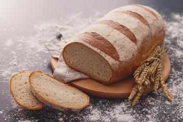 loaf of bread on black background