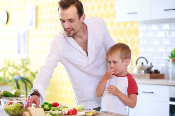 Picture of man and son preparing salad
