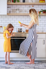 Image of mother and daughter cooking in kitchen