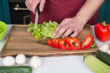 Be careful with knife. Chef teaches how quickly chop vegetables. Chop food safely and efficiently, ensure that you use the right tools. Learn how hold knife correctly and use right chopping technique