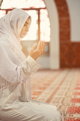 Arabic Young muslim woman praying in mosque